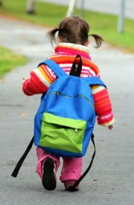 big knapsack on small child
